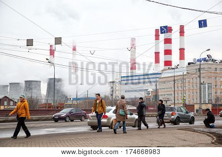 MOSCOW, RUSSIA - MAR 5, 2017: The movement of people on the street Vavilov. Smoking chimneys, the lives of people in the industrial area.