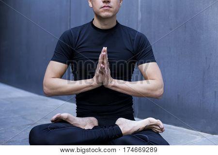 Cool yoga teacher practicing yoga outdoors in Barcelona