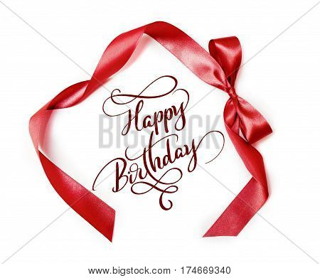 brown ribbon with a bow on a white background and text Happy Birthday. Calligraphy lettering.