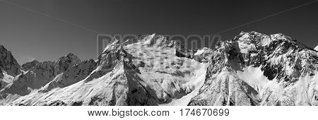 Black And White Panorama Of Snow Mountains.