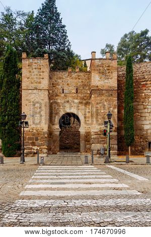 Gate in the old fortress wall of the city of Toledo. Spain.