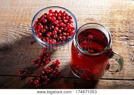 refreshing vitamin drink cranberry juice in a glass on a wooden background