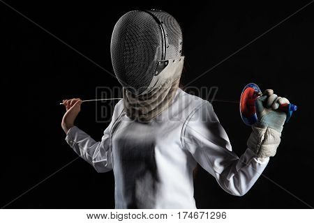Portrait of fencer woman wearing white fencing costume. Isolated on black background.