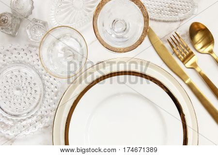 Chic and elegant table setting top view with glamorous dishes.