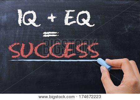 Success motivation phrase on blackboard with chalk