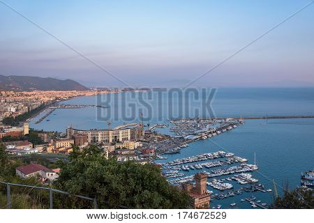 View of passenger port and marina in Salerno at sunset