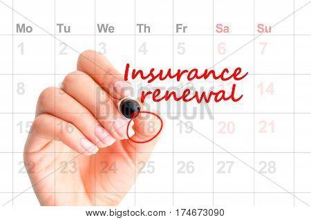 Insurance renewal reminder in calendar handwritten  by woman hand