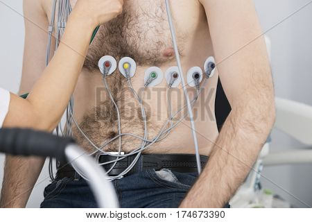 Patient With Electrodes Attached On Body Being Examined By Docto
