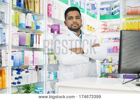 Confident Chemist In Labcoat Standing Arms Crossed