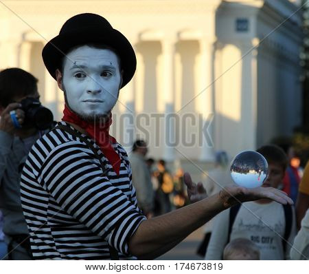Moscow, Russia - Sep 7, 2014: Clown With A Magic Crystal Ball On A Holiday Devoted To The City Day O