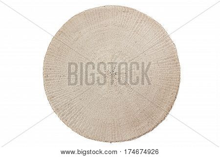 Round beige wicker placemat isolated on white background