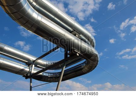 steel pipes under blue sky in industrial zone