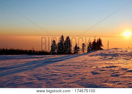 Sunset in the snowy mountains and smog in the valley