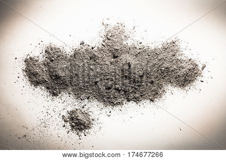 Ash dust sand or dirt on a pile as death cremation remains grey burnt trash concept background