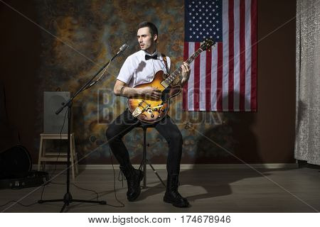 Moscow, Russia - Mart 03, 2017: Young rock musician with a vintage electric guitar Gibson es-345 1969 model year