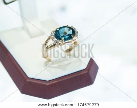 diamond ring in a gift box. White background.