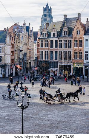 GHENT, BELGIUM - JANUARY 29, 2017: Horse carriage in Market Square in the UNESCO World Heritage Old Town of Bruges Belgium