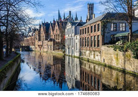GHENT, BELGIUM - JANUARY 29, 2017: Reflection of old buildings in the UNESCO World Heritage Old Town of Bruges Belgium