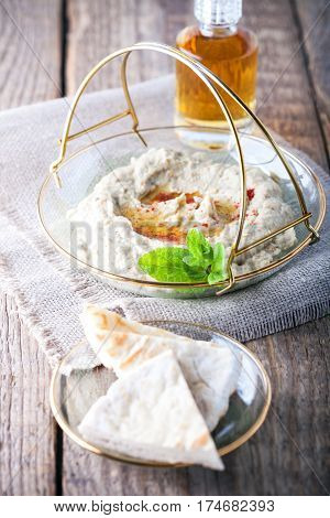 Baba ghanoush, eggplant dip mediterranean food on a wooden table