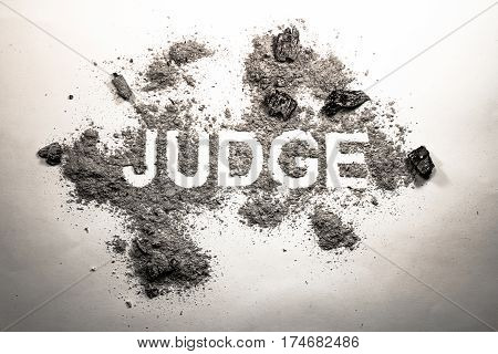 Word judge written in dirt filth ash grime dust as justice injustice judgment legal dirty corrupt court law concept lent or background