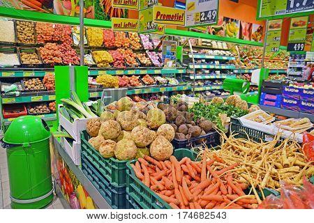 Caransebes Romania - November 22 2013: Vegetables on shelves at the kaufland supermarket in caransebes romania. shot taken on october 22nd 2013