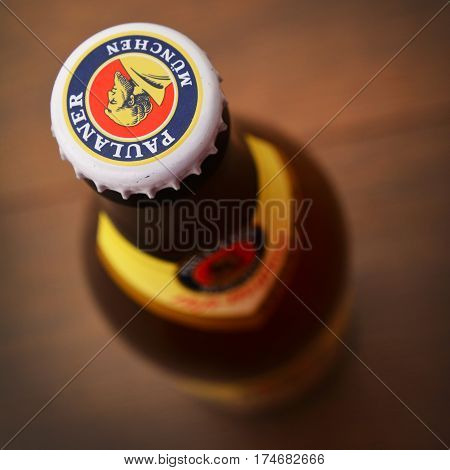 Caransebes Romania - February 6: close-up of a paulaner beer bottle cap. shot taken on february 6th 2016