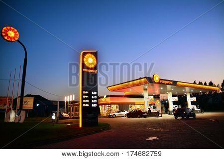 Caransebes Romania - October 10 2014: Night shot of a gas station in Caransebes Romania. Shot taken on October 10th 2014