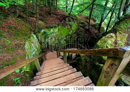 Hiking staircase through a narrow rock slot at Turkey Run State Park in Indiana