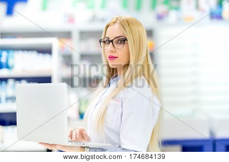 Pharmacist And Scientist Using Modern Technology In Pharmacy. Pharmacist Selling Antibiotics In Drug