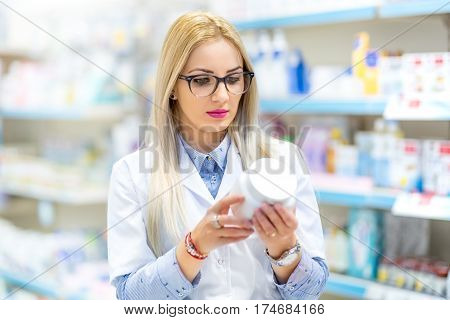 Professional Doctor, Medical Nurse And Pharmacist Reading The Drug Label In Pharmacy