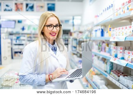 Medical Researcher And Pharmaceutical Scients Using Laptop And Internet For Business