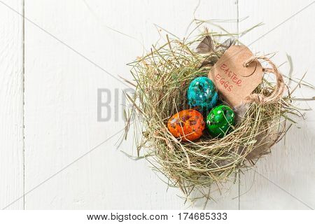 Quail Easter Eggs With Feathers And Hay