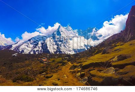 Mountain landscape with white peak. Icy mountain landscape with high peak and valley. Nepal nature environment concept. Severe climate or weather of Himalayas. Wild place outdoor traveling
