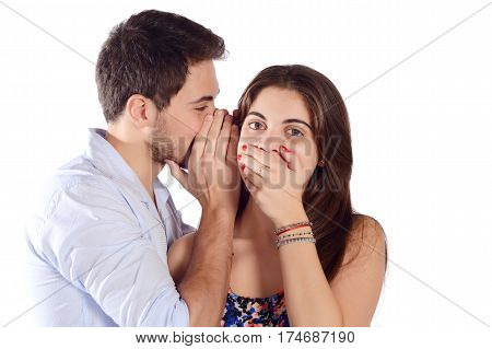 Man Whispering To Girlfriend.