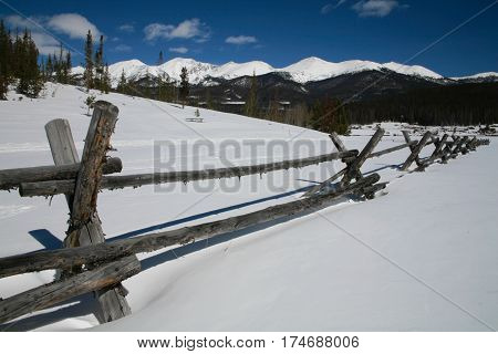 Winter Blue Sky Rocky Mountain Backcountry Fence