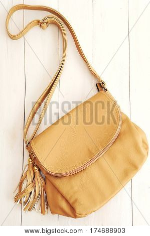 A stylish bag on a wooden background