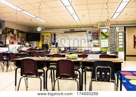 School concept. Back to school, School classroom with empty school chairs and tables, classroom without students, School supplies on blackboard, School of Schoolchild and student education.