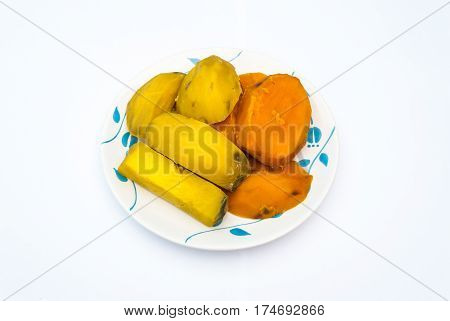 Many Pieces Of Steam Yellow And Orange Yam Without Peel On Plate, Isolated