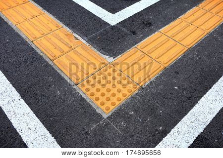 braille block on tactile paving for blind handicap on tiles pathway