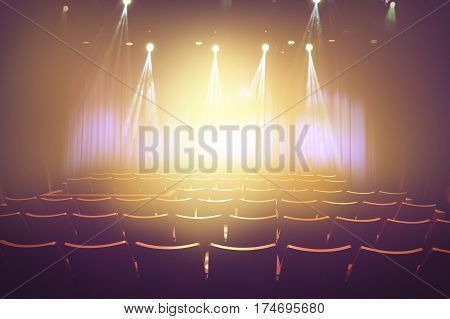 vintage theater with lighting spot on stage before showtime empty auditorium with seats