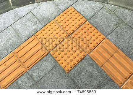 braille block tactile paving for blind handicap on tiles pathway