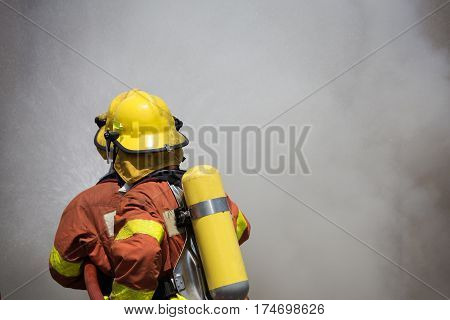 two firefighters fire fighting suround with dark smoke in cinematic tone