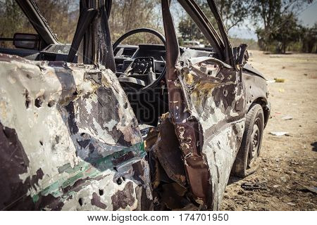 simulated wrecked car evidence from explosion in forensic training with cinematic tone