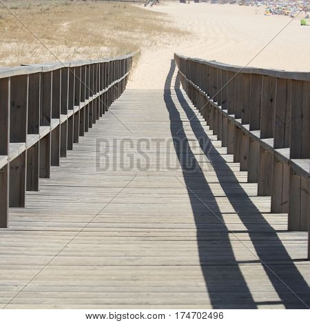 wooden walking path at the beach.