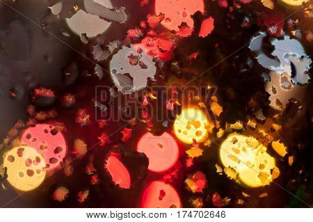 Abstract blurred of colorful lights in bokeh Christmas background on water