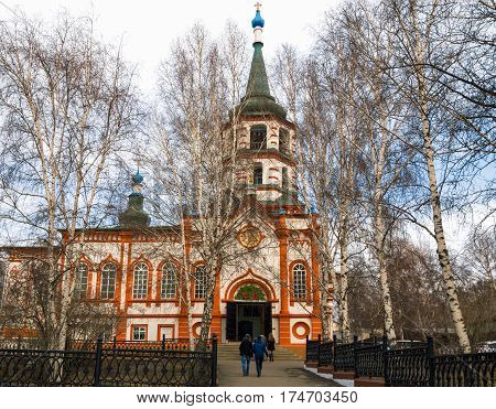 Youth goes to the Church of the Exaltation of the Cross. The city of Irkutsk, Russia