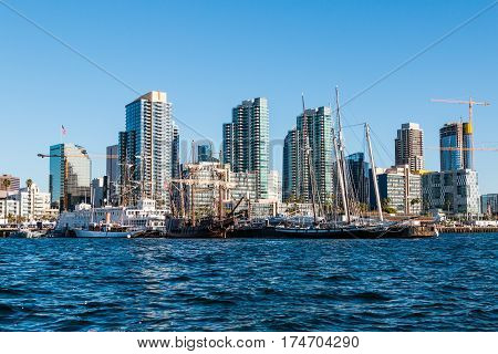 SAN DIEGO, CALIFORNIA - MARCH 2, 2017:  Historic vessels of the Maritime Museum of San Diego and the downtown city skyline.