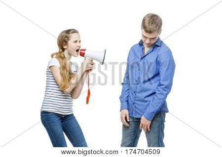 Teen age girl screaming at boy through megaphone. Brother and sister isolated on white background. Copy space.