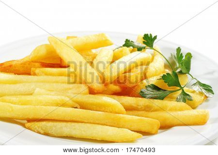 Side Dish French Fries Served with Parsley. Isolated on White Background