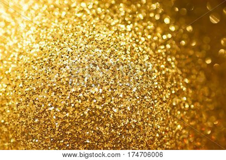 Gold glitter background Defocused abstract bright light